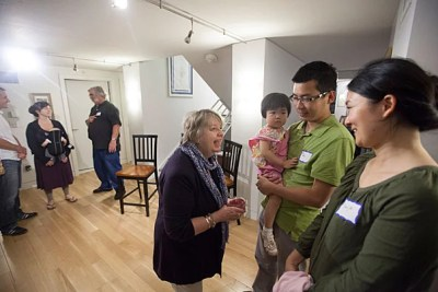 Doreen Hogle (from left), co-master of Dudley House, meets with Peabody Terrace residents Claire Zou, 2, GSAS graduate student Ge Zou, and Yunjie Peng.