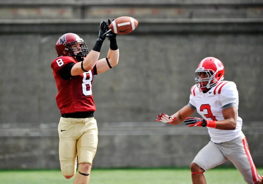 Crimson wide receiver Andrew Berg `14 hauls in the first of his three TD catches during the first half.