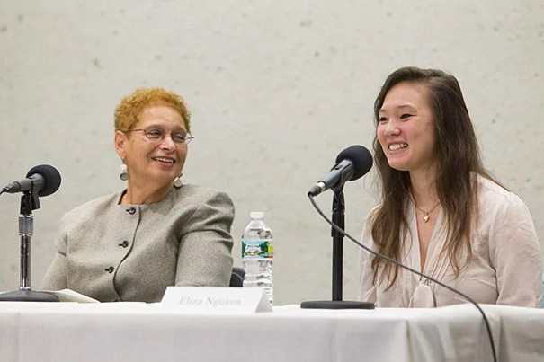 """It wasn't that long ago that interracialism was dangerous,"" said E. Dolores Johnson (left), a Harvard Business School grad who is writing a book about her parents' experience in a biracial community in Buffalo, N.Y. Johnson, seen here with Eliza Nguyen, president of the Harvard Half Asian People's Association, participated in a panel discussion called ""American Masala: Race Mixing, the Spice of Life or Watering Down Cultures?"""