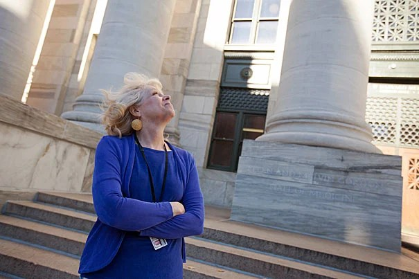 """Margaret Livingstone, a Harvard Medical School professor of neurobiology, points out that the columns at Gordon Hall were designed to look taller by making them more narrow toward the top. """"If you take home any message from my talk today, I hope you will take home the idea that vision is information processing, not image transmission,"""" said Livingstone at the Mind/Brain/Behavior 2012-2013 Distinguished Harvard Lecture."""