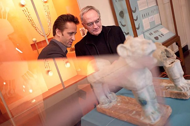 Joseph Greene (right), assistant director of Harvard's Semitic Museum, and Adam Aja, assistant curator of collections, re-create a ceramic lion that likely flanked an image of the goddess Ishtar in a temple in Nuzi. The project will blend fragments of the original statue held by the museum with pieces created through 3-D scans of its intact mirror image.