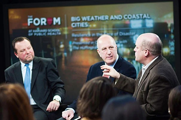 """""""I promise there will be surprises. No matter how well we prepare, there will be system failures,"""" said Daniel Schrag (far right), director of the Harvard University Center for the Environment. Paul Biddinger (left) and Jerold Kayden were among the other panelists for the forum on """"Big Weather and Coastal Cities"""" at the Harvard School of Public Health."""