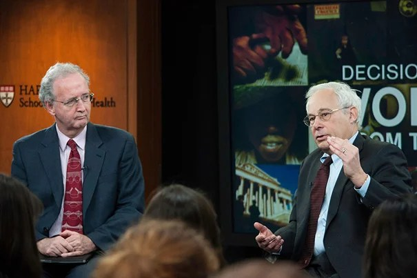 """You can't ask a kid to be healthy and exercise if he can't safely stand on the front porch, never mind run down the street,"" said Donald Berwick (right), a lecturer at Harvard Medical School. His talk was sponsored by the Harvard School of Public Health's Voices from the Field program, and was hosted by John McDonough (left), professor of the practice of public health."