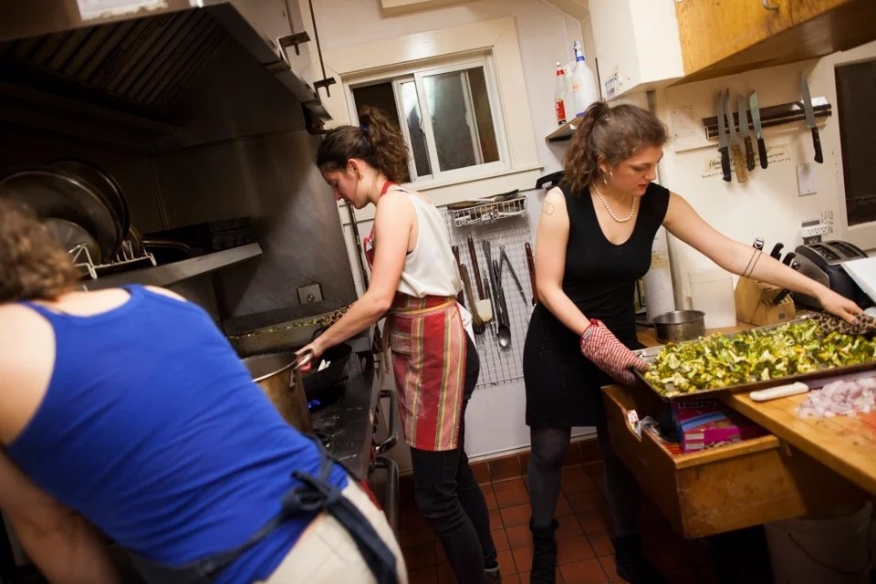 Too many cooks in the kitchen? Xanthia Tucker '13 (from left), Zoe Tucker '13, and Charlotte Lieberman '13 work around each other.