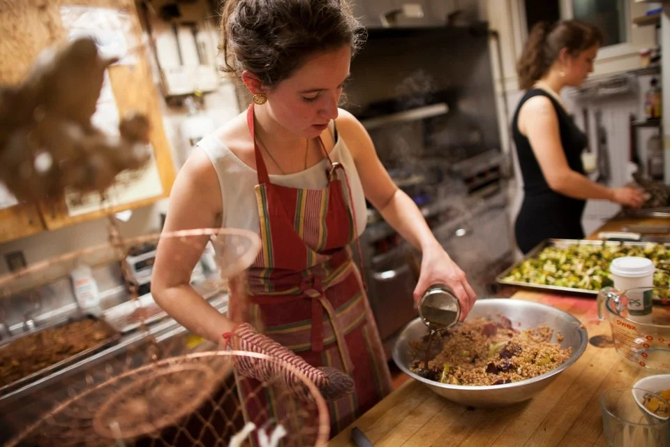 Zoe Tucker '13 (left) and Charlotte Lieberman '13 prepare farro, a grain, with roasted beets and apples and broccoli roasted with honey, lemon, and cayenne.