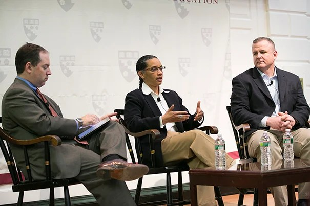 """Moderator Andrew Rotherham (from left) talked with former Marines Jenny DuFresne and Steve Scarfe. DuFresne heads up Septima Clark Public Charter School for boys in D.C. """"We have a mission statement, just as we did in the Marine Corps,"""" said DuFresne."""