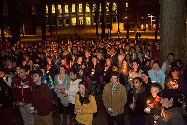 People gather for a candle light vigil at The Memorial Church at Harvard University in the wake of the violence visited upon the city of Boston yesterday during the Boston Marathon. Photo by Kris Snibbe/Harvard Staff Photographer
