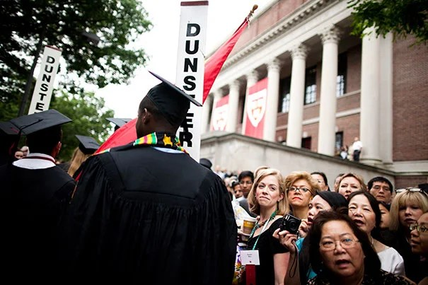 The Morning Exercises take place in Tercentenary Theatre. Family members watch graduates process in front of the steps of Widener Library during the Commencement ceremony of 2010. Photo by Stephanie Mitchell/Harvard Staff Photographer
