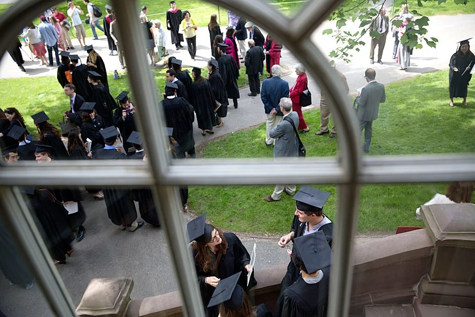 Outside Harvard Hall, the procession to the Phi Beta Kappa Literary Exercises heads toward Sanders Theatre. Kris Snibbe/Harvard Staff Photographer