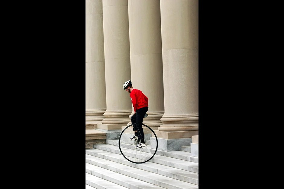 Up, down, and all around goes Zach Warren, a Divinity School student whose unicycling benefits an Afghan children's circus. Stephanie Mitchell/Harvard Staff Photographer