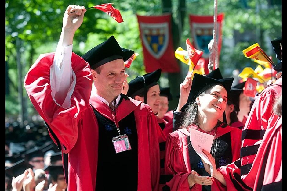 Graduate School of Arts and Sciences students Lambert and Severine Williams exult. Jon Chase/Harvard Staff Photographer