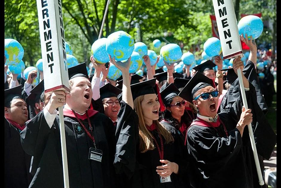 Harvard Kennedy School graduates Matthew Stolhandske (from left), Mari A. Oltra, and Zhen Liu celebrate their degree conferment.  Jon Chase/Harvard Staff Photographer