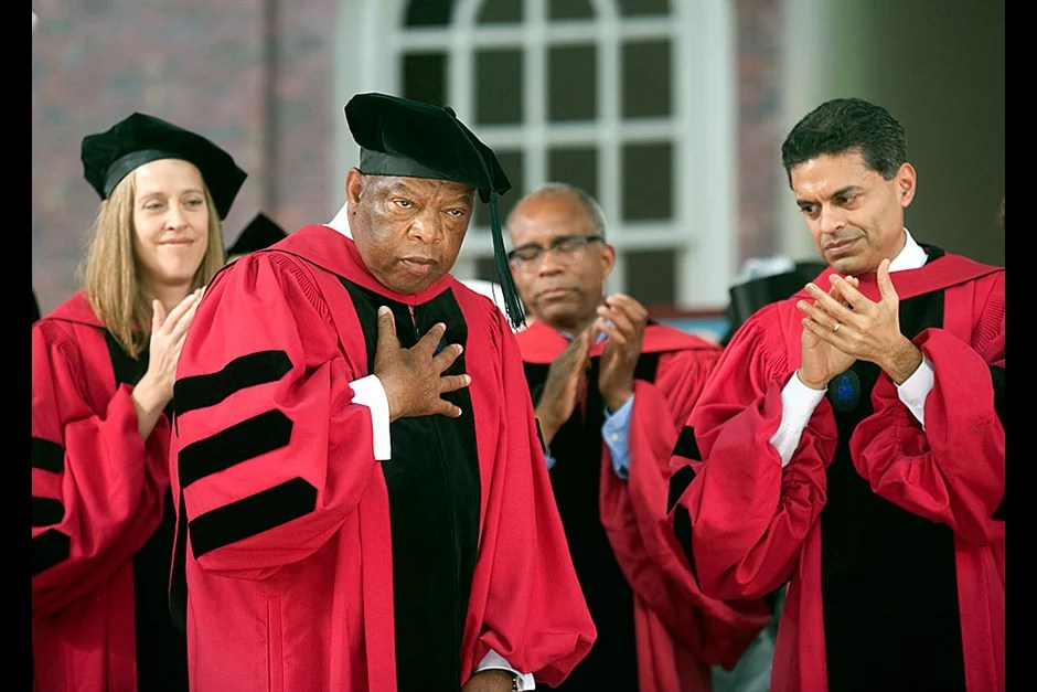 Honorand John Lewis replied to his standing ovation by placing his hand on his heart. Jon Chase/Harvard Staff Photographer