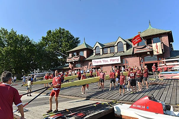 Hundreds of former members of Harry Parker's crews rowed the Charles River on Saturday morning in remembrance of the legendary coach, who passed away in June.
