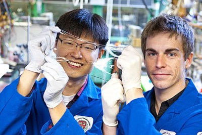 Jeong-Yun Sun (left) and Christoph Keplinger show off an ionically conductive material that is very stretchy and completely transparent. Eliza Grinnell/SEAS Communications
