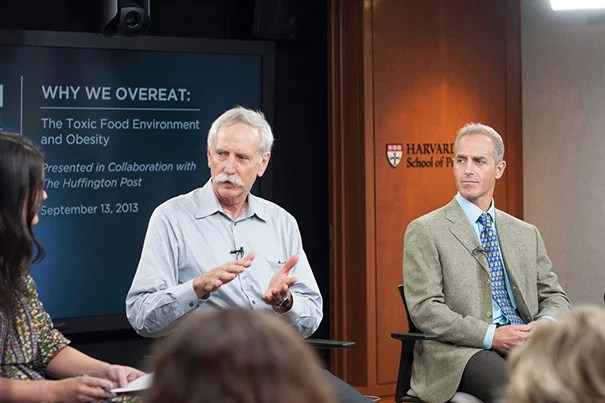 Walter Willett (center) told moderator Meredith Melnick that children are being exploited by marketing strategists. Later, both Willett and Dariush Mozaffarian (right) rejected the idea that genetics plays a role in the growing obesity problem in America.