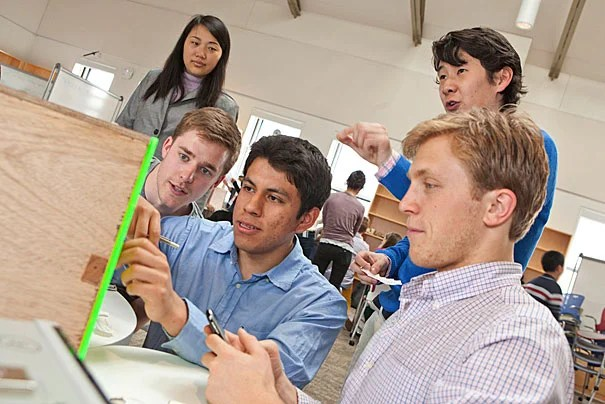 Team-based design projects feature prominently in AP 50. Aaron Perez '15 (center) and his teammates (photo 1) solve a series of riddles to break into a safe designed by another team of students in Professor Eric Mazur's class  (photo 2). Joy Hui '16 and Perez use a pan pipe to prove their point (photo 3).