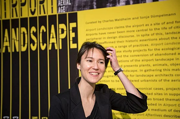 """The airport itself is this nice nucleus that can act as a container of broader ideas,"" said Sonja Duempelmann (photo 1), who helped organize ""Airport Landscape: Urban Ecologies in the Aerial Age"" at Gund Hall this week. An exhibit of the same name is also on view through Dec. 19. Its color scheme, signage, and scale are all echoes of modern airports. It is the first time, organizers said, that every display space in Gund Hall has been given over to a single theme (photos 2 and 3."