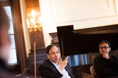 """Sugata Bose (left) discussed a new composition inspired by the Ganges River with Sandeep Das (photo 1). During the Silk Road Ensemble's three-day residency at Harvard, Bose offered suggestions to Japanese flutist Kojiro Umezaki (photo 2). """"We are trying as an organization to go just beyond the Silk Road trade route and think about it more as just a metaphor,"""" said violinist and composer Colin Jacobsen (photo 3)."""