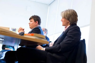 """Russian human rights lawyer Sergei Golubok (center) said the biggest legal concern in Russia is the lack of judicial independence. Golubok was joined by Anton Burkov (right), who simply stated, """"We need to use what we have."""""""
