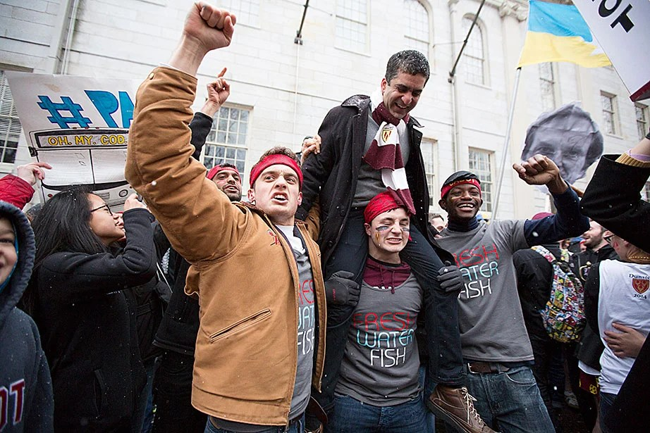 Students from Cabot House hoist into the air House Co-Master Rakesh Khurana, who is also the incoming dean of Harvard College. Rose Lincoln/Harvard Staff Photographer
