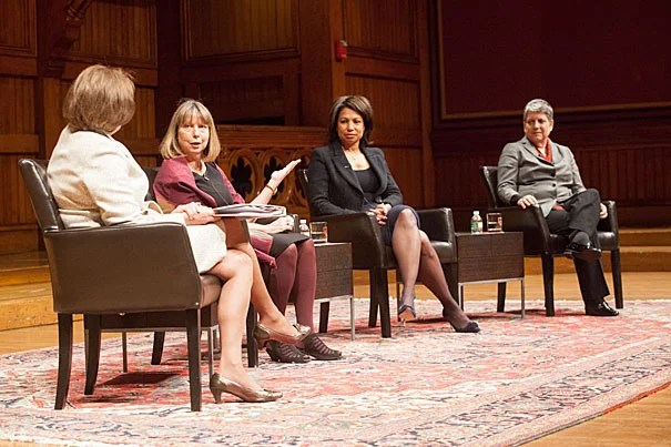 "At Sanders Theatre, a panel of top female leaders examined the evolving role of women. Karen Gordon Mills (from left, photo 1) posed questions to Jill Abramson, Edith Cooper, and Janet Napolitano, following an introduction by Harvard University President Drew Faust (photo 2). Faust called the gathering a ""critical conversation"" about the challenges and opportunities women face today. ""What does power require of me beyond a thick skin?"" she asked."
