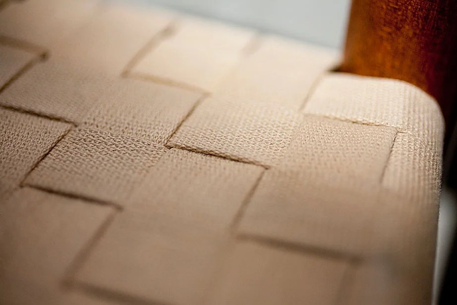 The woven seat of a Shaker chair.