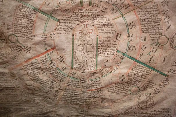 A close-up image (photo 1) shows MS Typ 584, a ca. 1200 pedagogical and devotional tool showing seven vices and seven virtues as interpreted by Hugh of St. Victor. Professor Thomas Forrest Kelly (from left, photo 2), graduate student Zoe Walls, Curator of Early Books and Manuscripts William Stoneman, and Professor Beverly Mayne Kienzle put the final touches on an exhibit of medieval scrolls now on display at Houghton Library.