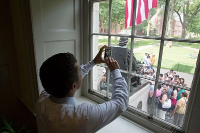 """""""I can't help but remember that 43 years ago this month, my family immigrated to the United States,"""" said Rakesh Khurana, Harvard College's new dean (photo 1). """"Looking outside my window and seeing the flag and the John Harvard Statue, I just feel incredible gratitude to my parents, who had the courage to come to this nation."""" Khurana greeted guests outside his office (photo 2), while inside he read cards from well-wishers, complete with orchids (photo 3)."""