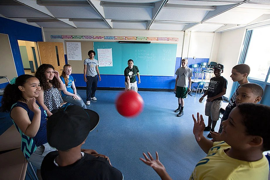 """Counselors Sammy Cruz (center, left) and Beto Vargas play """"the name game"""" — an orientation activity that helps students learn each other's names."""