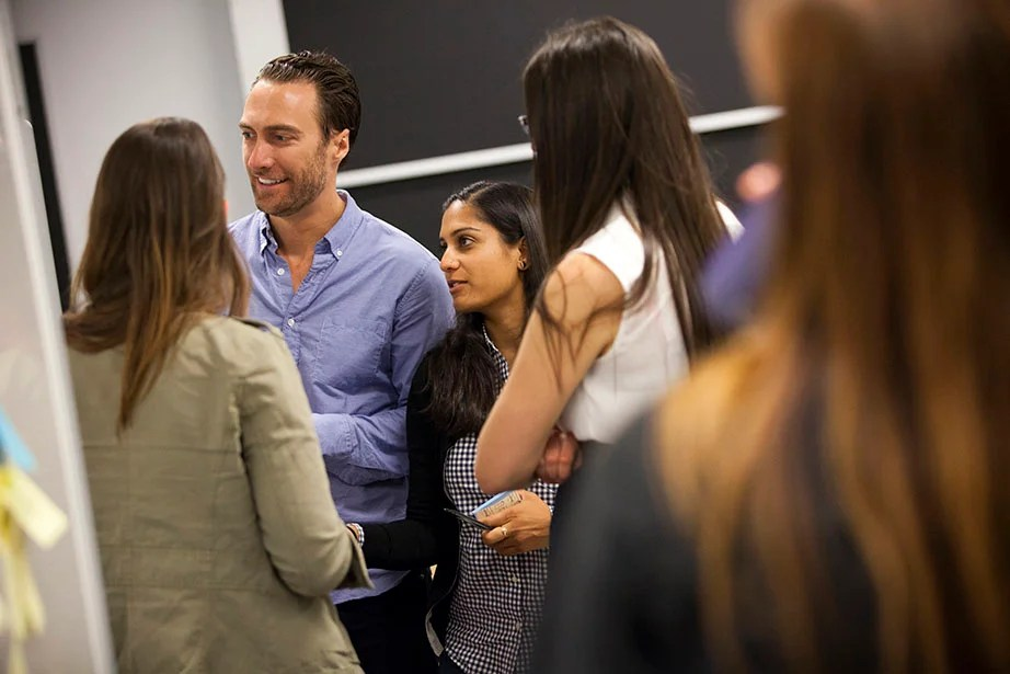 Graduate students, like Harvard Business School's Adam Flick, and Harvard School of Public Health's Lakshmi Karra, cross-register from across the University to learn about design thinking.