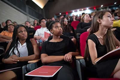 "Harvard President Drew Faust spoke at the Booker T. Washington High School for the Performing and Visual Arts. Students, including Lashaun Morgan (from left), Kennedi Mayes, and Cristina Flores listened as Faust made her ""case for college."" Stephanie Mitchell/Harvard Staff Photographer"