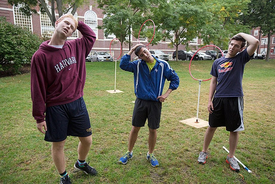 Martin Reindl '15 (from left), Phillip Ramirez '18, and Anthony Ramicone '15 stretch before practice.