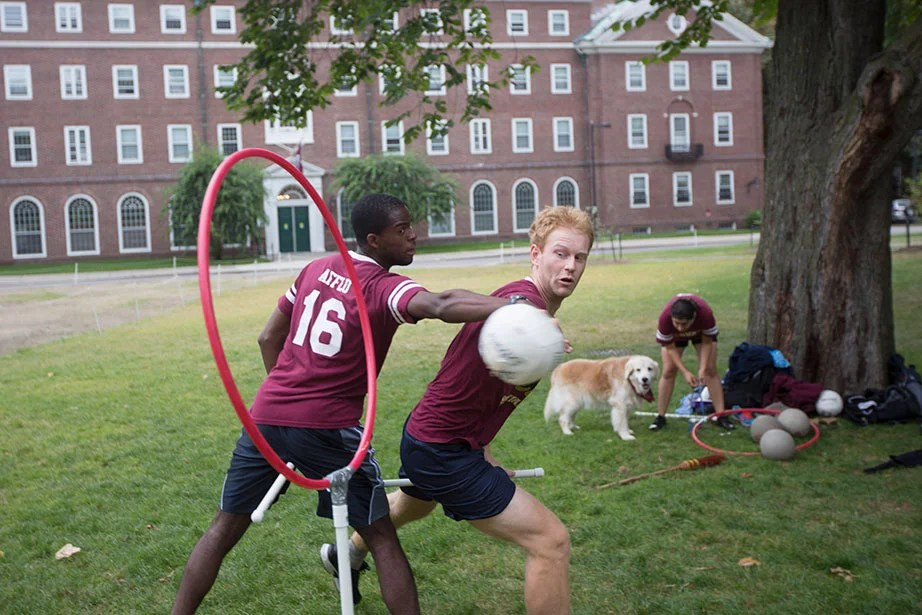 Ernest Afflu '15 (left) and Martin Reindl '15 vie for the quaffle — the name of the volleyball in Quidditch.