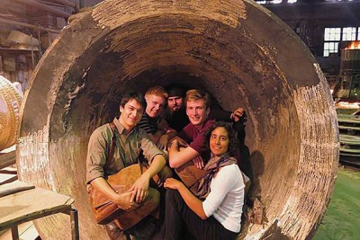 Christopher Wankel '13 (from left), Harry Hild '16, Father Roman, Dylan Perese '16, and Harvard teaching fellow Amy Koenig are pictured at the Litex Foundry in Moscow.