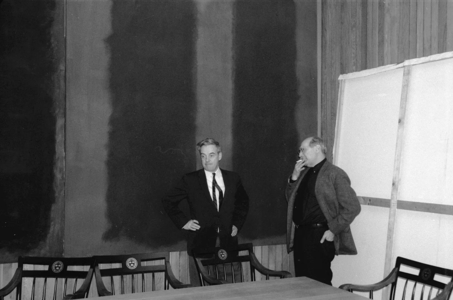 """John Coolidge, former director of the Fogg Museum, and Mark Rothko (right) in front of """"Panel Two"""" and """"Panel Three"""" of the Harvard murals on the tenth floor of Harvard's Holyoke Center, 1963. © 2009 Kate Rothko Prizel and Christopher Rothko / Artists Rights Society (ARS), New York. Elizabeth H. Jones, ©President and Fellows of Harvard College"""