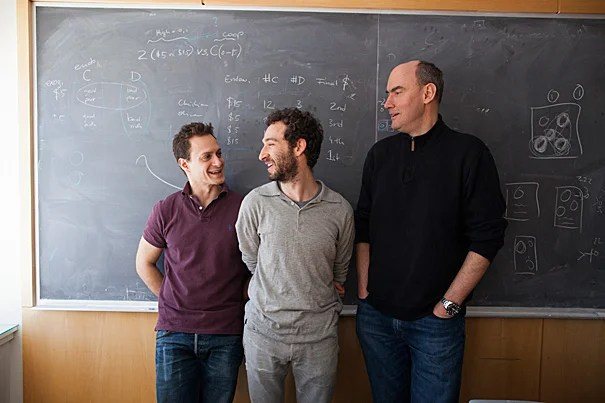 """For years, people have been asking those of us who study cooperation about the motive that is behind an action,"" said Harvard Professor Martin Nowak. Nowak (from right), Moshe Hoffman, and Erez Yoeli have developed a first-of-its-kind model, dubbed the ""envelope game,"" that can help researchers to understand not only why humans evolved to be cooperative but why they evolved to cooperate in a principled way."