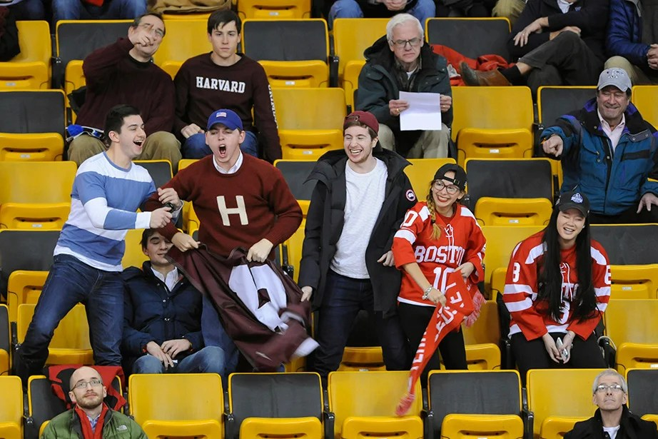 A small but vocal Crimson cheering section tries to outshout BU rivals as their teams battle on the ice. Jon Chase/Harvard Staff Photographer