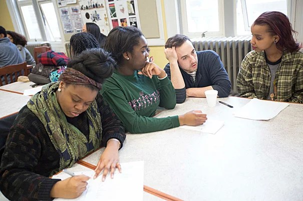 "Brendan Shea (third from left), manager of education and community programs at the American Repertory Theater (A.R.T.), worked with Boston Green Academy seniors Kimberly Kirlew (from left), Joyce Ogbesoyen, and Ester Farah during a workshop that focused on the A.R.T.'s production of Suzan-Lori Parks' ""Father Comes Home From the Wars (Parts 1, 2, & 3)."""