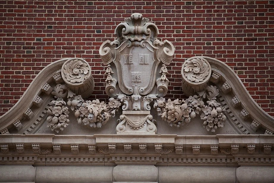 From 1896, a Veritas shield on the exterior of what was once the Fogg Museum and is now the Harvard Art Museums.
