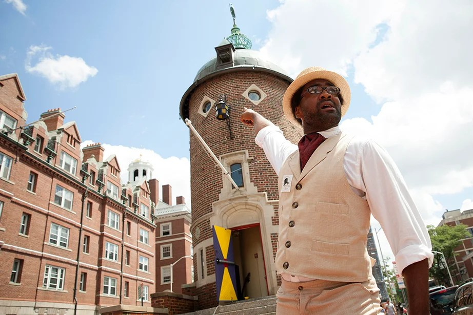 Stewart Smith, a tour guide with Cambridge Historical Tours, speaks about his favorite campus facts and tour questions. He is pictured in Harvard Square outside the Harvard Lampoon. Stephanie Mitchell/Harvard Staff Photographer