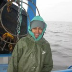 """Postdoctoral fellow Amina Schartup, the paper's first author, aboard the """"What's Happening"""" on Lake Melville. In 2017, a dam will flood a large region upstream from an estuarine fjord called Lake Melville."""