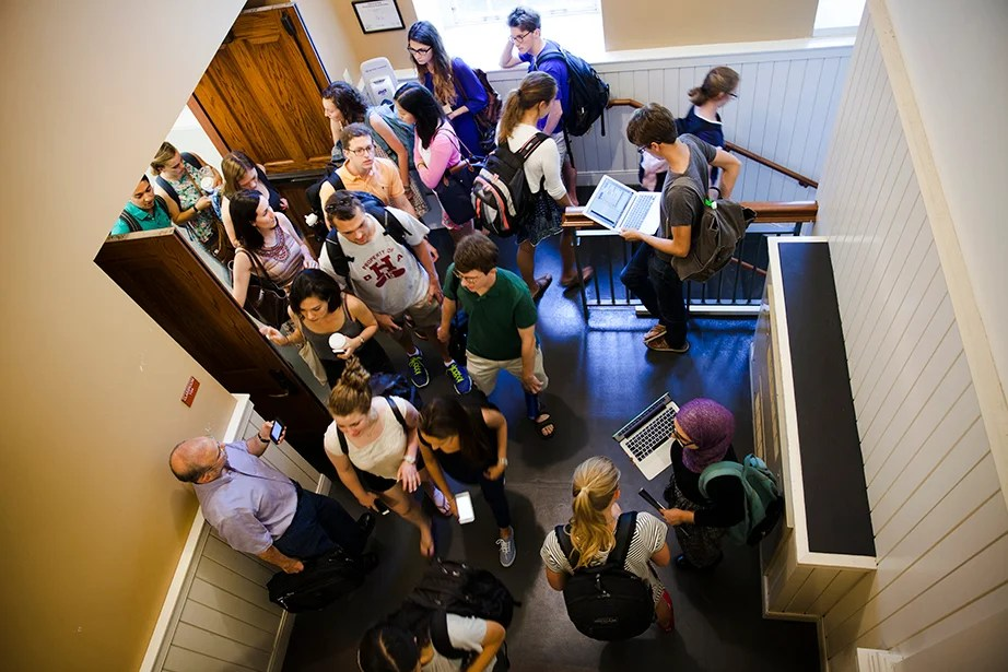 Students flood out of a Harvard Hall classroom during Shopping Week, a window at the start of each semester when students can try out courses before formally registering. Stephanie Mitchell/Harvard Staff Photographer