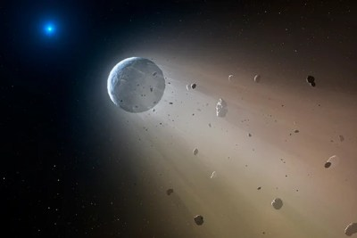 """In this artist's conception, a Ceres-like asteroid is slowly disintegrating as it orbits a white dwarf star. """"We now have a 'smoking gun' linking white dwarf pollution to the destruction of rocky planets,"""" says Andrew Vanderburg of the Harvard-Smithsonian Center for Astrophysics. Within about a million years the object will be destroyed, leaving a thin dusting of metals on the surface of the white dwarf."""