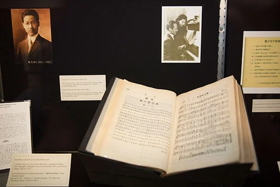 Curator, Lingwei Qiu, Library Assistant shows music and images that are part of an exhibit at the Loeb Music Library on the 100th anniversary of the first publication of Chinese Piano music. Kris Snibbe/Harvard Staff Photographer