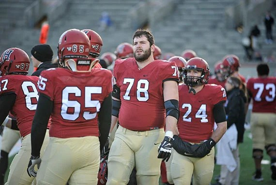 Harvard football v. Penn. Outside linebacker Cole Toner '16 looks at the clock as time winds down with the Crimson losing to Penn. Jon Chase/Harvard Staff Photographer