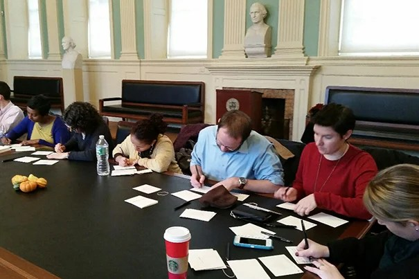 Harvard Faculty of Arts and Sciences staff members gathered in the faculty room at University Hall to see friends, enjoy cider and cookies, and write personal thank-you notes to co-workers.