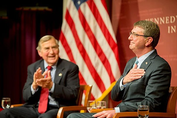 Defense Secretary Ashton Carter (right) returned Tuesday evening to the Harvard Kennedy School, where he was a faculty member from 1984 to early 2011, to talk with Graham Allison, director of the Belfer Center for Science and International Affairs, about the conflict in Syria and to pitch Harvard students on the many public service opportunities available in the military.