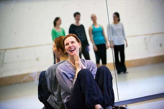 Harvard Dance Director Jill Johnson teaches the Harvard Dance Project. This faculty-led, student performance company gives students the opportunity to be original cast members and collaborators in two or more diverse dance works created by professional choreographers. Jill Johnson is pictured applauding a dance during class in the Harvard Dance Center. Stephanie Mitchell/Harvard Staff Photographer