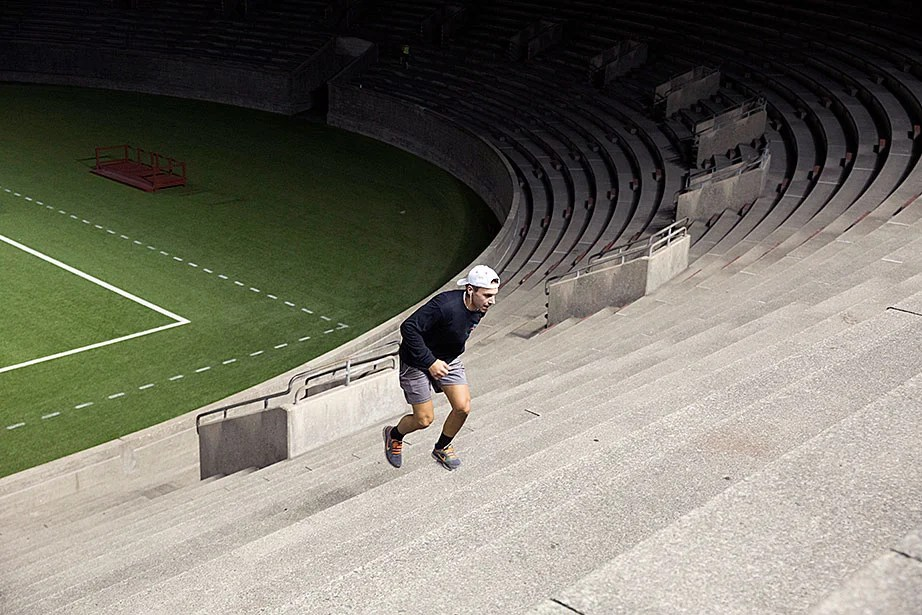 In a photo that might conjure up the loneliness of the long distance runner, Tyler Zolud, a student at Northeastern who trains with his dad, makes his way up the stadium seats. Not surprisingly, the younger Tyler, at 19, was a row or two ahead of his father. The workout is intense, and there is not much conversation.